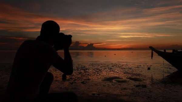 Landscape Photographer at Work During Dusk Royalty-free stock video