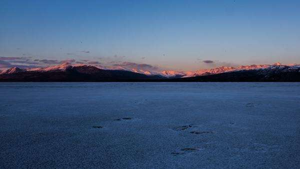 Timelapse of sunset looking east at mountains over a lake in Kluane National Park, Yukon, Canada Royalty-free stock video