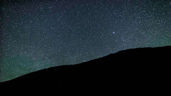Silhouette of a mountain with the Milkyway Rising overtop Royalty-free stock video