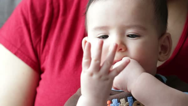 Baby boy (four months' old) is amazed at his own fingers. Royalty-free stock video