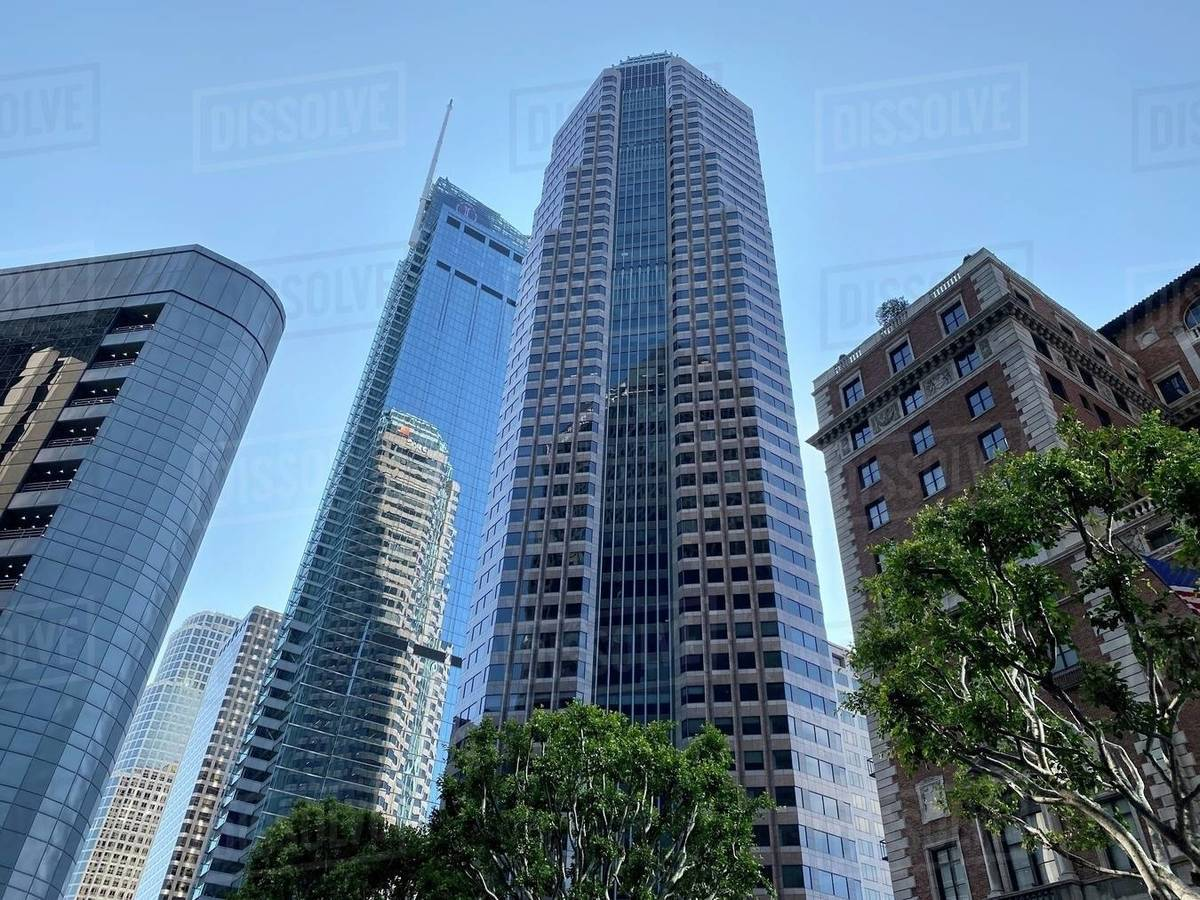 LOS ANGELES, CA, MAR 2020: looking up at skyscrapers on Figueroa St at Wilshire Blvd in Downtown. Corner of the Jonathan Club visible on right. Royalty-free stock photo
