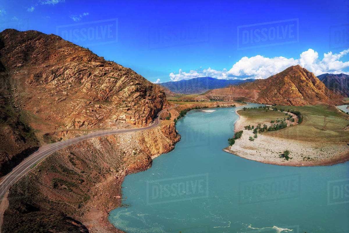 Chuysky trakt road and Katun river in the Altai mountains. Aerial drone photo. According to many sources, it is part of the most beautiful road in the world. Royalty-free stock photo