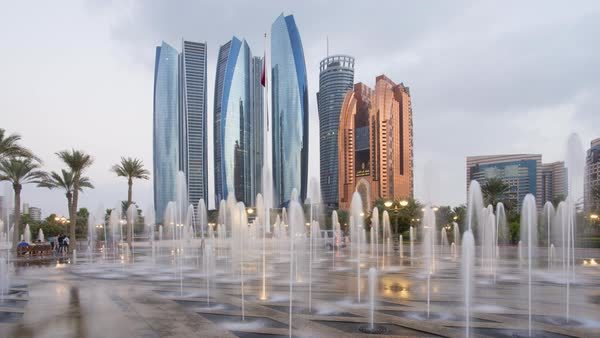 Etihad Towers time lapse viewed over the fountains of the Emirates Palace Hotel, Abu Dhabi, United Arab Emirates, Middle East Royalty-free stock video