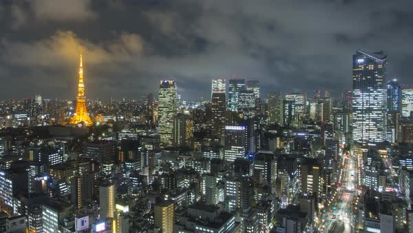 Japan, Tokyo, elevated time lapse night view of the city skyline and iconic illuminated Tokyo Tower  Royalty-free stock video