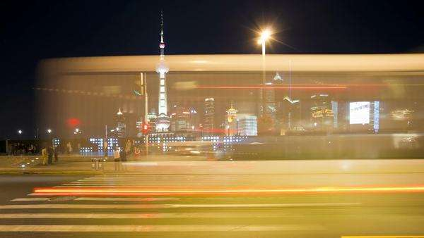 TL People crossing busy road in front of the new Pudong skyline, illuminated at night, the Bund, Shanghai, China Royalty-free stock video
