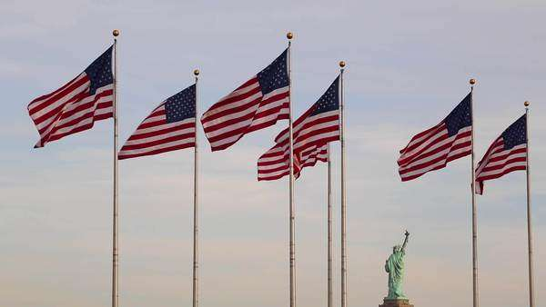 Statue of Liberty and US Flags, New York City, USA Royalty-free stock video