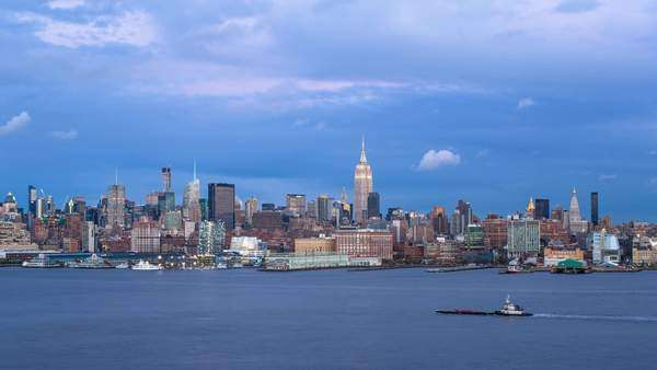 Manhattan, Dusk view of the Empire State Building and Midtown Manhattan across the Hudson River, New York, United States of America - timelapse Royalty-free stock video