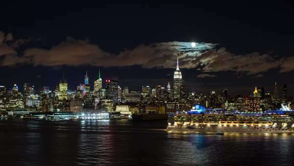 Manhattan, Moonrise over the Empire State Building and Midtown Manhattan looking across the Hudson River, New York, United States of America - timelapse Royalty-free stock video