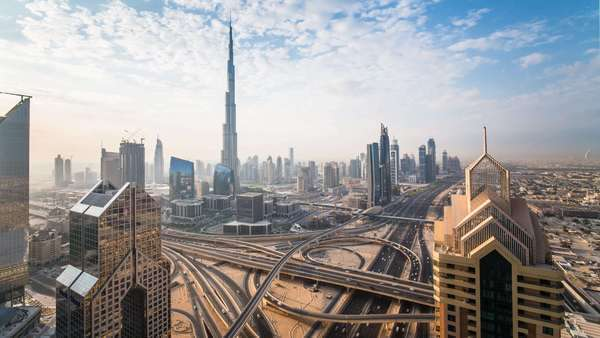 United Arab Emirates, Dubai, elevated view of the new Dubai skyline, the Burj Khalifa, modern architecture and skyscrappers on Sheikh Zayed Road - timelapse Royalty-free stock video