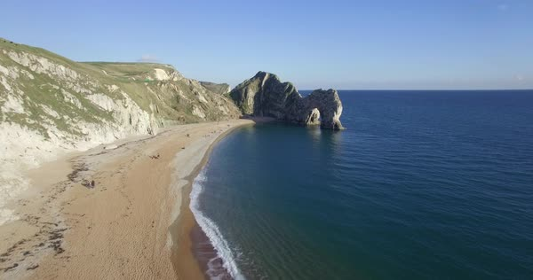 Aerial of Durdle Door at West Lulworth, natural limestone arch, Dorset, England, United Kingdom, Europe Royalty-free stock video