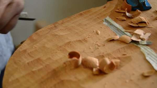 Luthier working on the top of a bowed instrument Royalty-free stock video