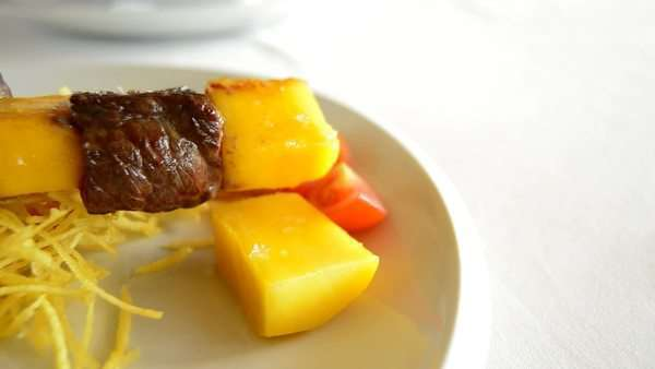 Skewer of mango fruit and meat of cow or beef at grill panoramic Royalty-free stock video