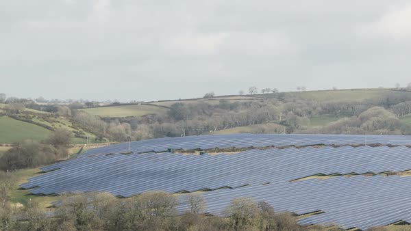 Timelapse of a solar farm in a rural landscape. Wales, UK. Rights-managed stock video