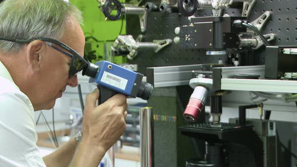 Fabrication of 5D nanostructured glass data disc. Footage of optoelectronics researcher Peter Kazansky (born 1956) filming the fabrication of a 5D data storage disc. Rights-managed stock video