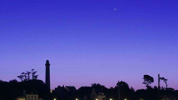 Timelapse film of Venus in conjunction with Saturn, with Mercury rising above the horizon. Filmed at Benodet lighthouse in France. Rights-managed stock video