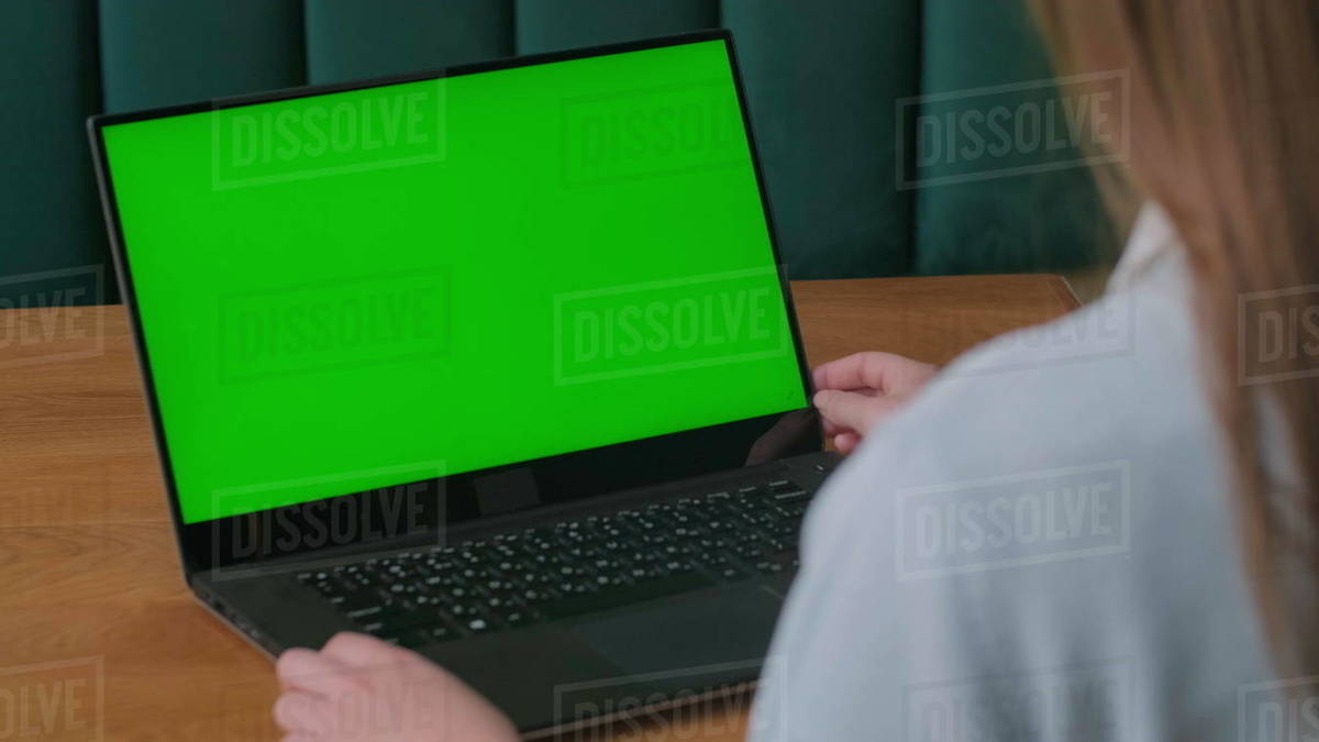 Close-up of a woman's Hands Working on Green Screen on a Laptop. 4k shot Royalty-free stock photo