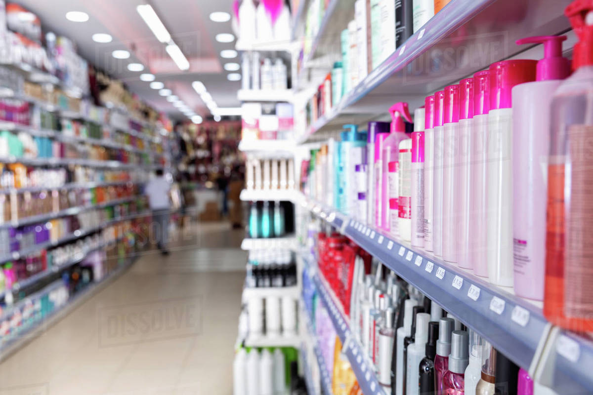 Colorful  modern showcase in cosmetic boutique with variety of hair care treatments Royalty-free stock photo