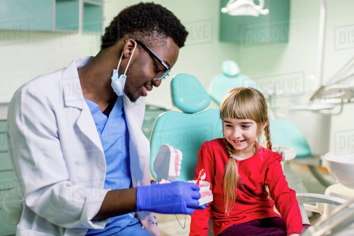 Dentist examines baby girl's teeth.Prophylaxis of caries, milk teeth, pediatrics. Royalty-free stock photo