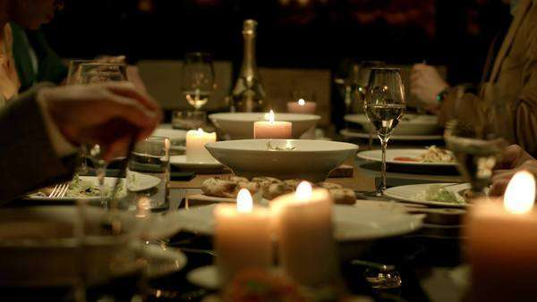 Group of people having dinner at a restaurant. Royalty-free stock video