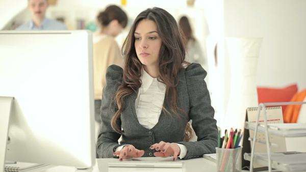 Businesswoman working at her desk. Royalty-free stock video