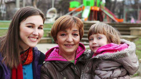 Three generations: grandmother, mother and daughter outdoors. Royalty-free stock video