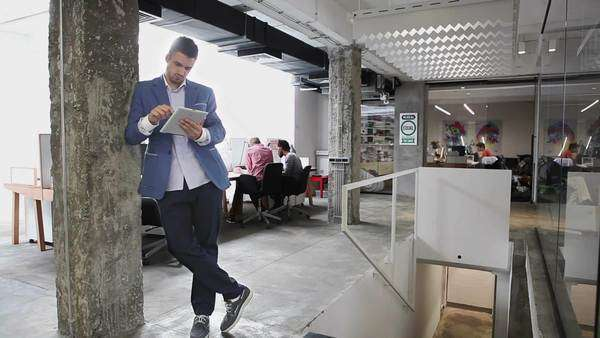 Caucasian Businessman Using a Tablet at the Office Royalty-free stock video