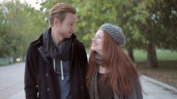 Happy ginger couple having a walk and chatting. Royalty-free stock video