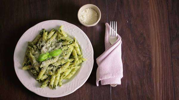Pasta with pesto and parmesan in close-up. Royalty-free stock video