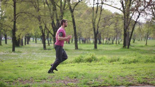 Fit young Caucasian man jogging outdoors. Royalty-free stock video