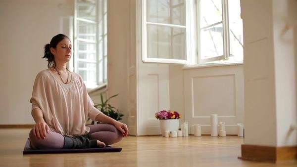 Caucasian woman meditating indoors. Royalty-free stock video