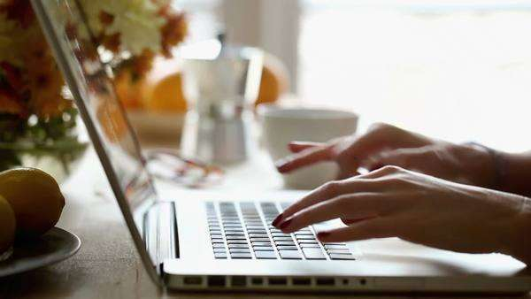 Hands of a Caucasian woman typing on a laptop keyboard. Royalty-free stock video