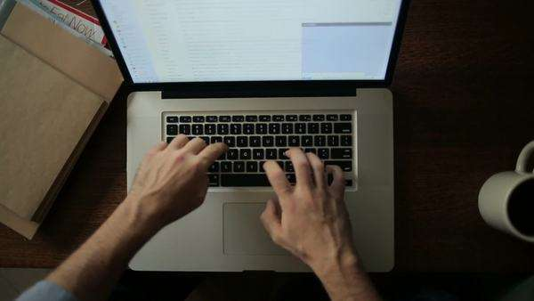 Hands of a man writing an e-mail on his laptop. Royalty-free stock video
