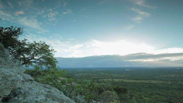 Timelapse shot of clouds moving over Phinda Private Game Reserve at sunrise Rights-managed stock video