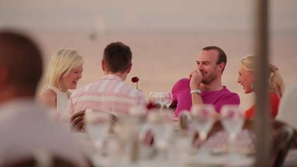Shot of two couples laughing at an outside table at the Grande Cafe, Beach in Cape Town Rights-managed stock video