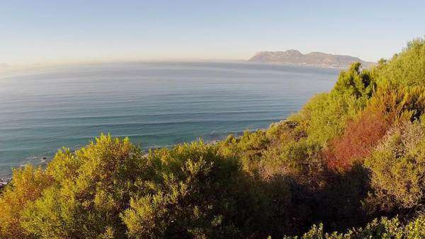 Aerial tracking shot over an area of the Cape Peninsula Rights-managed stock video