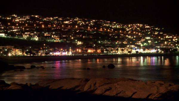 Time lapsed long shot of the beach front at night, Cape Town city in background Rights-managed stock video