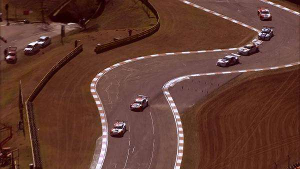 Aerial of cars racing around Kyalami Race Track Rights-managed stock video