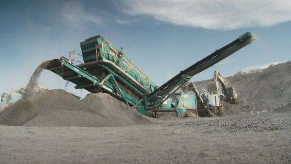 Mid shot of crushing plant working on an opencast mine Rights-managed stock video
