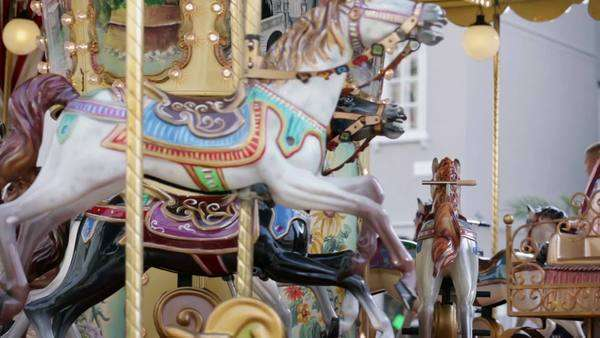 TRIESTE, ITALY - SEP 15, 2013: Wooden horses and fairytale carriges on running roundabout Royalty-free stock video