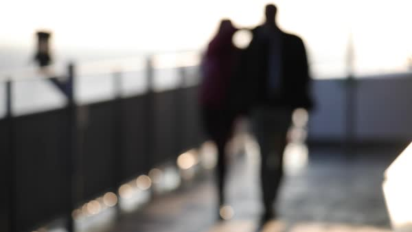 Slow motion blurred shot of a man and woman walking together Royalty-free stock video