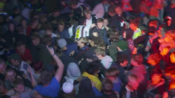 Out of focus shot of crowd dancing and jostling at a concert Royalty-free stock video