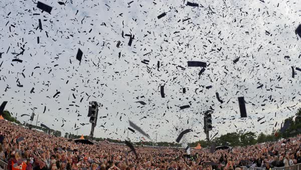 Hand-held shot of confetti falling on crowd at a concert Royalty-free stock video