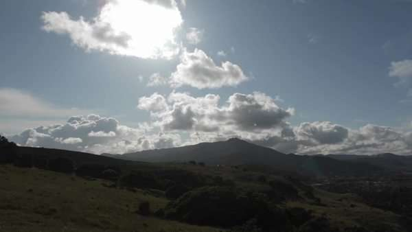 Clouds pass over mountains in a timelapse sequence. Royalty-free stock video