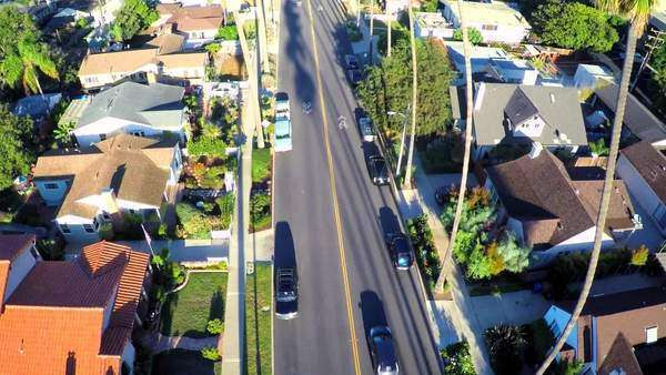 Beautiful rising aerial shot over a palm tree lined street in Southern California. Royalty-free stock video