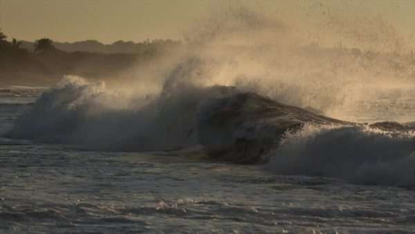 Waves roll into a beach following a big storm in slow motion. Royalty-free stock video