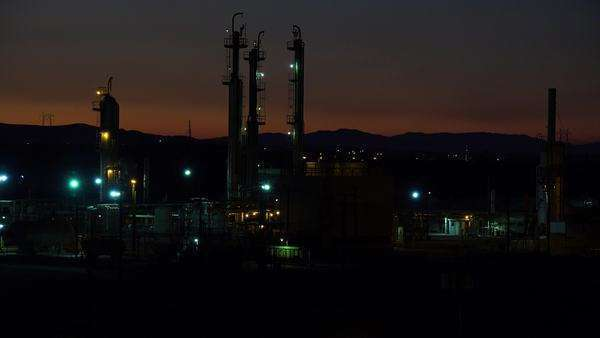 Establishing shots of an oil refinery at night. Royalty-free stock video