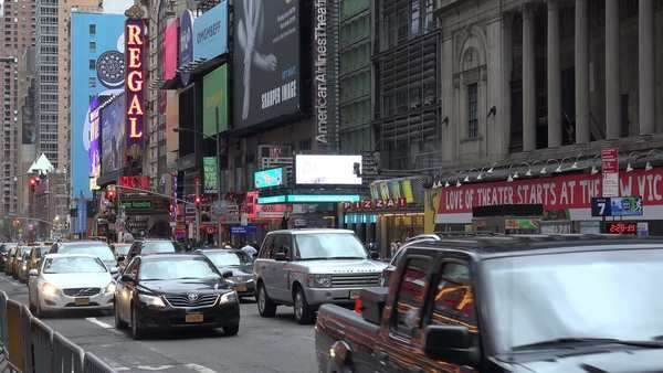 Traffic passes along Broadway with signs advertising the latest shows. Royalty-free stock video
