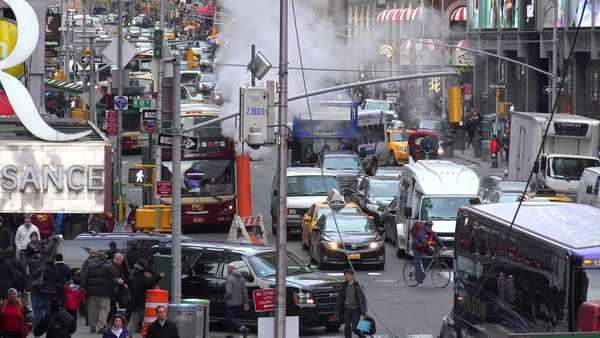 Crowds of cars, busses and pedestrians in Times Square, New York City. Royalty-free stock video