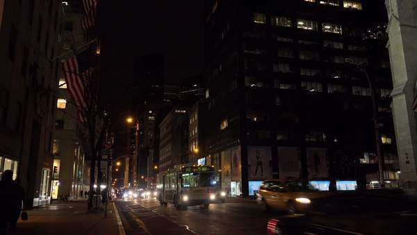 Traffic moves along New York's Fifth Ave. at night. Royalty-free stock video