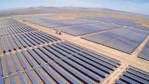 Aerial over a vast solar array farm in the California desert. Royalty-free stock video